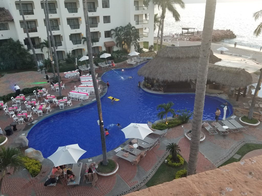 Plaza Pelicanos Grand Beach Resort pool view from balcony. Checking out all the hotties in the pool at the Plaza Pelicanos Puerto Vallarta. Swim your days away at Plaza Pelicanos Resort.