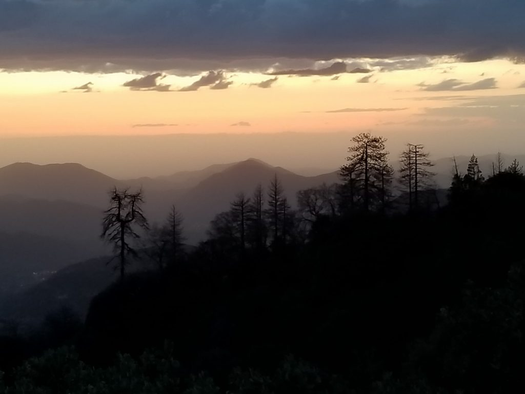 Sequoia National Forest Sunset. Sunset over the mountains. Seeking sunsets as a reason for traveling full time. Peaceful moments of traveling full time.