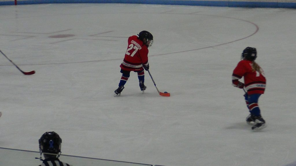 mite hockey, kid playing hockey